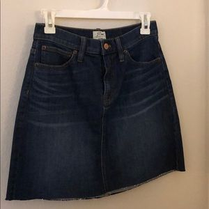Denim skirt with raw hem.